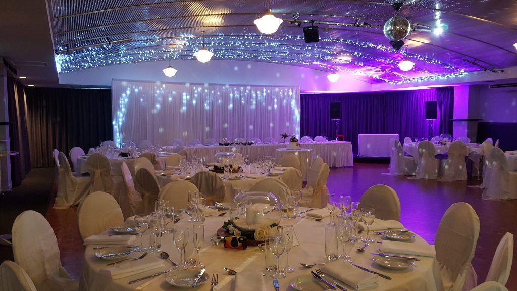 champagne wedding; fairy lights; fishbowl centrepieces; purple lights; mirror ball; dance floor; romantic; fannie bay