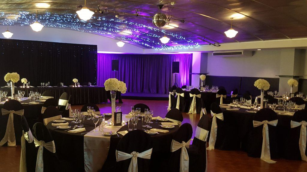 black and ivory wedding; elegant; tall vases; mirror ball; icicle lights; fannie bay
