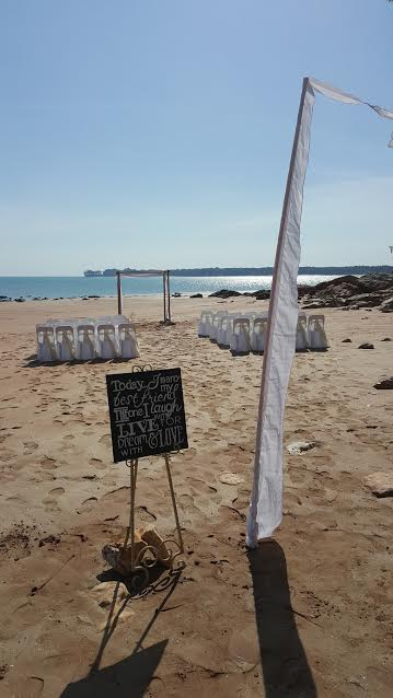 beach; white wedding; bamboo; signage; flag; fannie bay