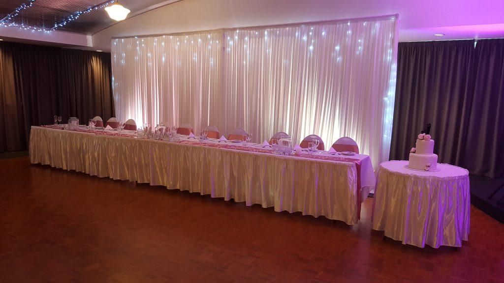 dusty rose; pink; bridal table; bridal party; icicle lights; fairy lights; fannie bay