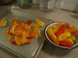 Clean the peppers and toss in olive oil.