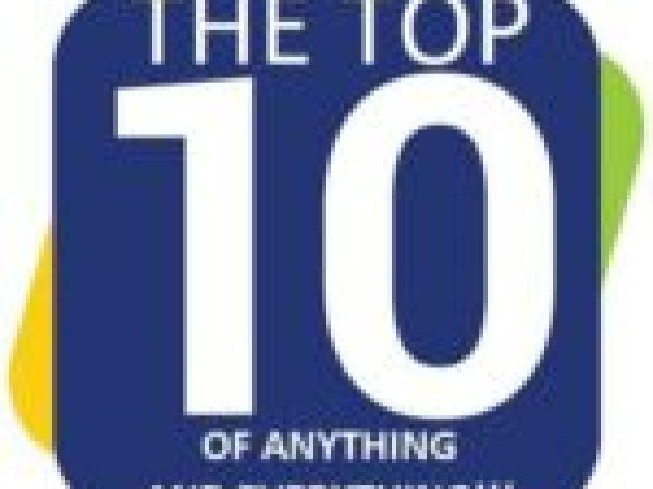 2 cats waiting under an umbrella