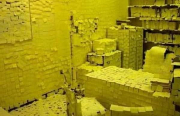 Office covered in Post-it notes for a prank