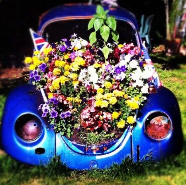 Blue Volkswagen Beetle Covered in Flowers