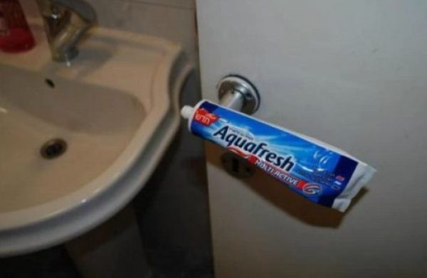 Old toothpaste tube used as a door handle