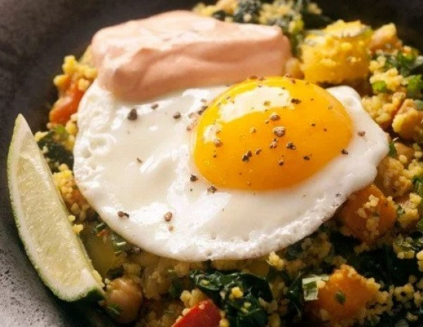 Braised Chickpeas and Vegetables with Couscous, Harissa Yogurt, and Soft Eggs