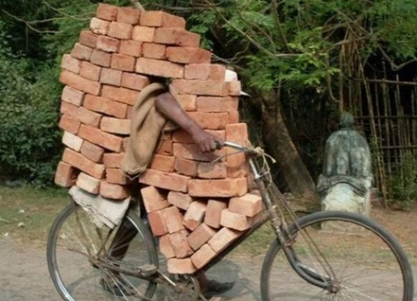 Bicycle Overloaded With Bricks