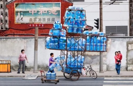Bicycle Overloaded With Water Bottles