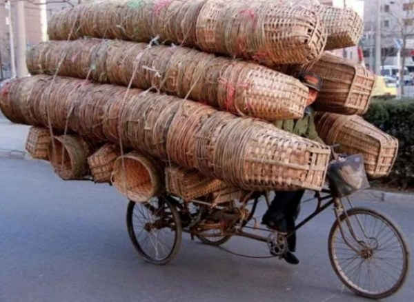 Bicycle Overloaded With Baskets