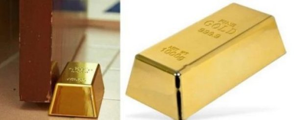 A door stop that looks like a gold bullion bar