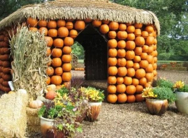 Hut art installation made of pumpkins