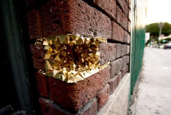 Hole in wall filled with Gold
