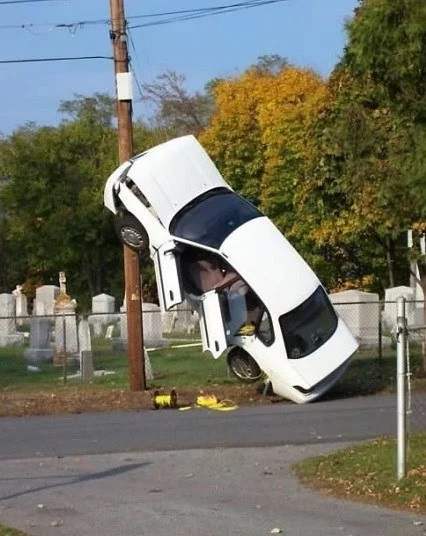 Car crash up a pole