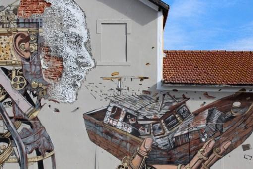Vhils & Pixelpancho collab in Lisbon