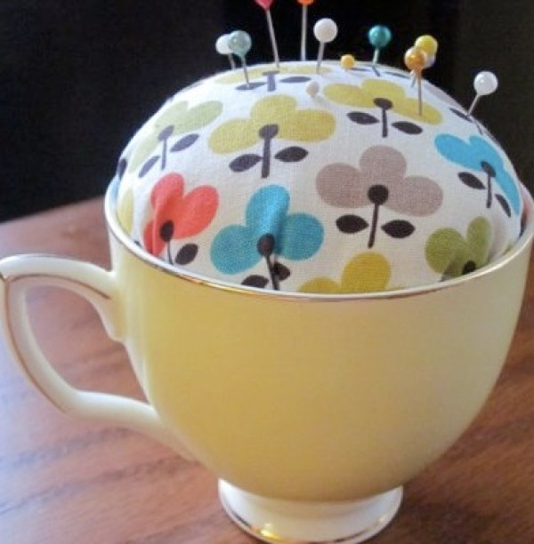 Old Mug Or Cup Used To Make Pincushion