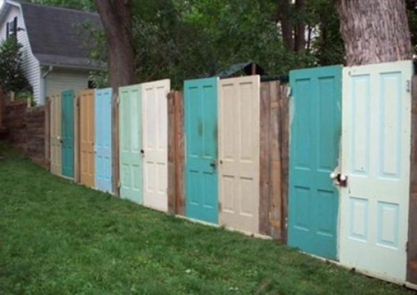 Doors Repurposed Into a Garden Fence