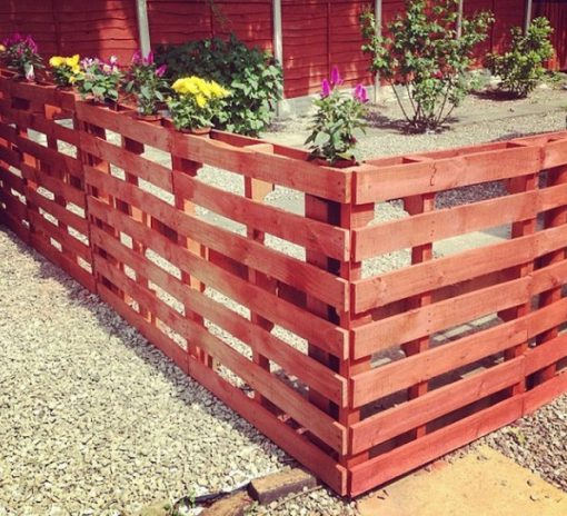 Old Wooden Pallets Transformed Into a Garden Fence / Divider