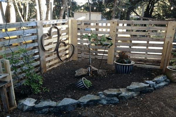 A Fence Made From Wooden Pallets