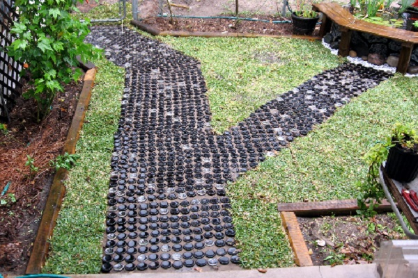 A Garden Path Made With Glass Bottles