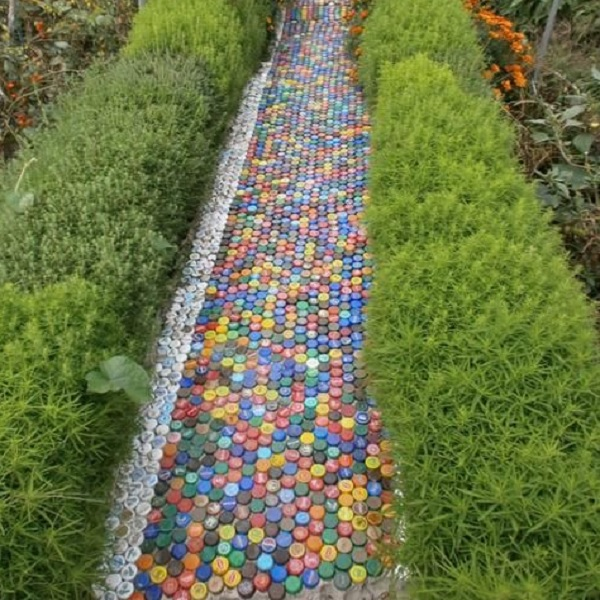 A Garden Path Made With Plastic Bottles Caps
