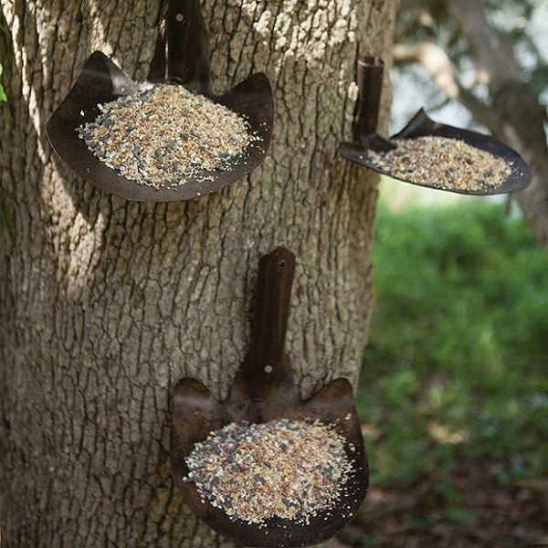 A Bird Feeder Made From Shovels