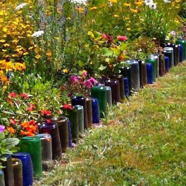 A Garden Border Made From Glass Bottles