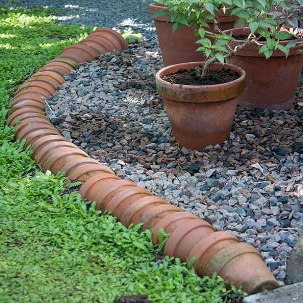 A Garden Border Made From Flowerpots