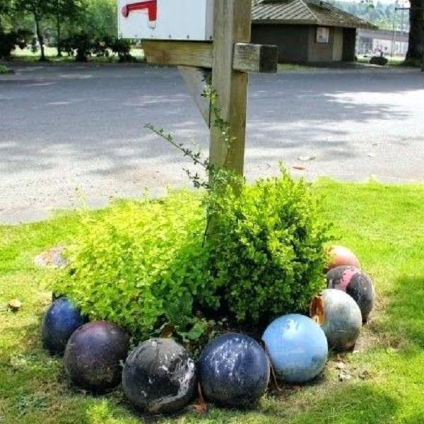 A Garden Border Made From Bowling Balls