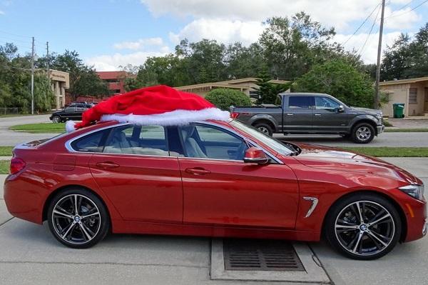 Festive Car With Santa Hat on