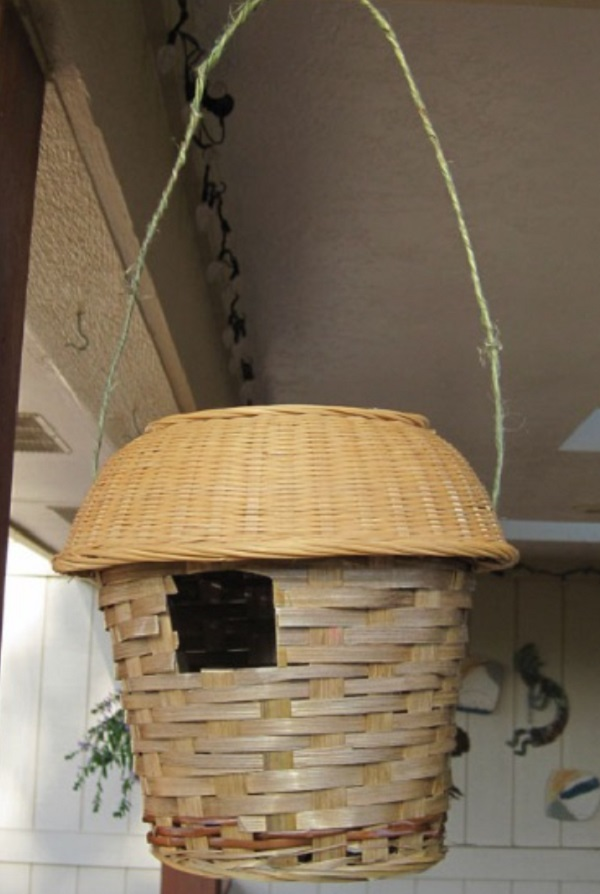 An Old Wicker Bin Used to Make a Birdhouse