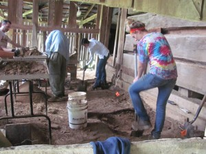 Students digging inside the barn, adjacent to the old store.