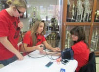Mrs. Reichert's Nursing students took blood pressures throughout the event. Pictured are Seniors Nellda Stevers and Jami Shipley measuring Mrs. Clayton's blood pressure.