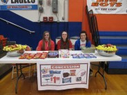Healthy snacks were available for purchase at the event. Volunteers pictured are: Junior Paige McKibben and Seniors Tabitha Rogers and Haley Edwards.