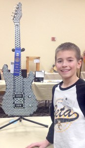 "Buncombe Grade School Junior Beta Club member Matthew Johnson took first place in the ""Sculpture"" competition at the Illinois Beta Convention held February 9 and 10, in Springfield, Illinois. In keeping with the 2015 National Beta theme ""Betas, Rocking the Country,"" Matthew designed his sculpture of a working guitar completely out of miscellaneous metal hardware pieces. Matthew, a sixth grader, is the son of Jeff and Elizabeth Johnson of Buncombe."