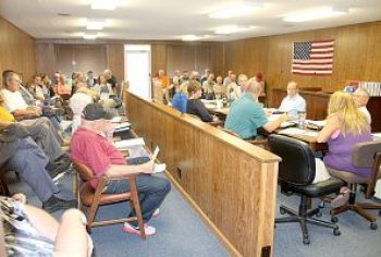 There was a full house Tuesday morning for the Johnson County Commissioners' regular meeting in the courtroom annex. Two of the three commissioners have proposed purchasing the closed Gambit Golf Course for the purpose of building a new county office complex there. More than forty county residents were at the meeting. Half of those in attendance voiced opposition to the proposal while the other half supports it. The discussion was postponed until the next meeting on Tuesday, May 24, at 6:00 p.m. in the Vienna High School commons. The Vienna Times photo