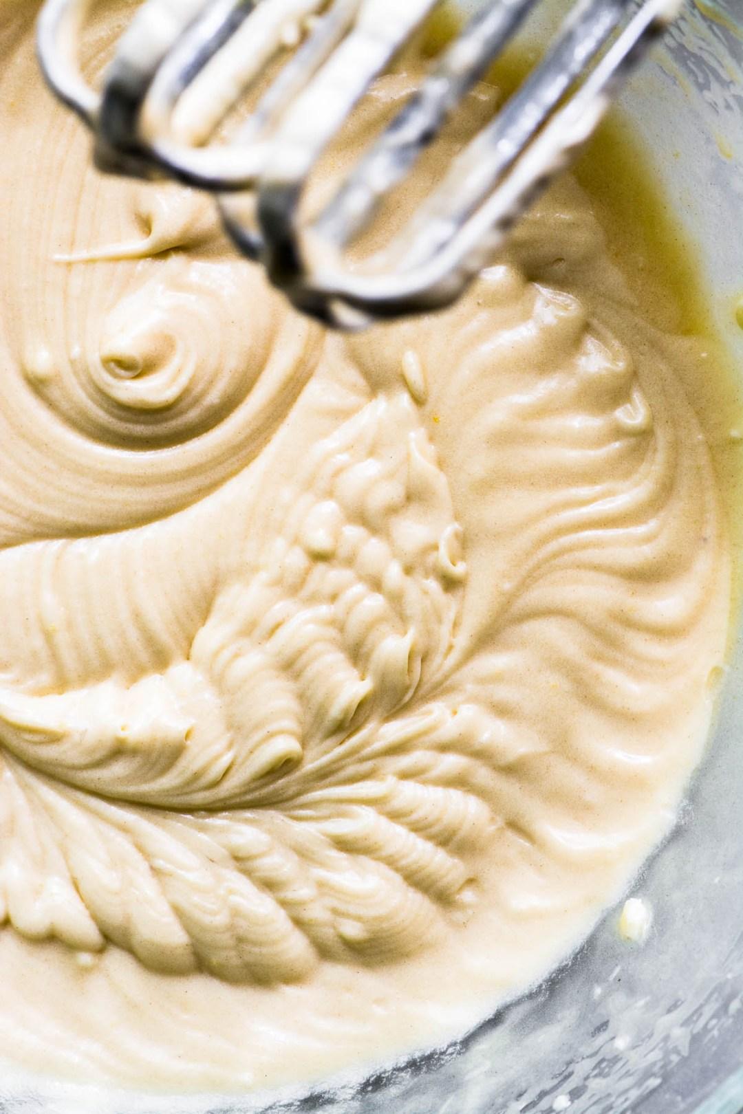 batter in a bowl for plum blitz kuchen cake