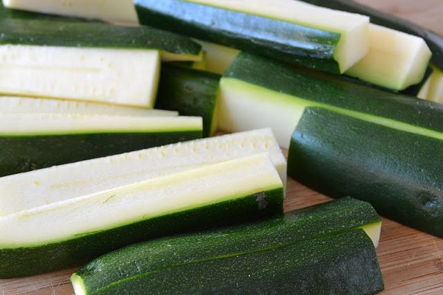Photo of zucchini cut into large strips for Beer battered zucchini with Lime Cilantro Aioli.