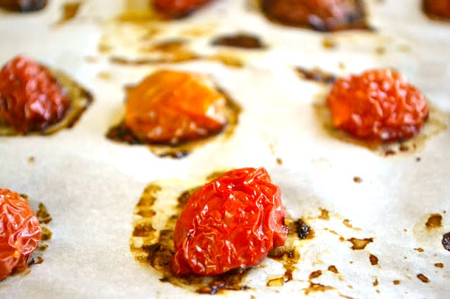 How to Dry Cherry Tomatoes ~ dried cherry tomatoes on parchment paper