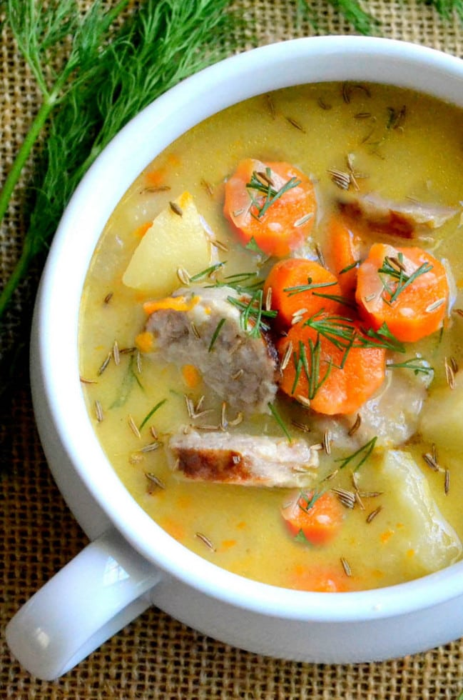 A bowl of cheddar and Bratwurst soup