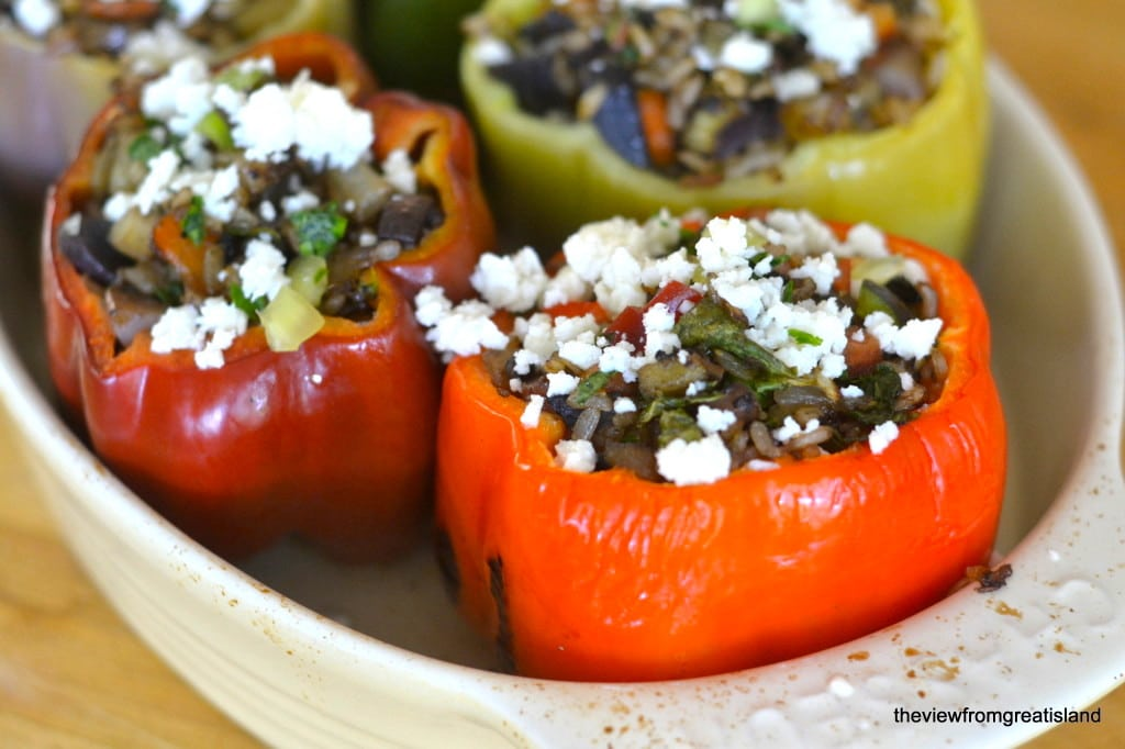 Colorful vegetarian stuffed peppers in a casserole dish