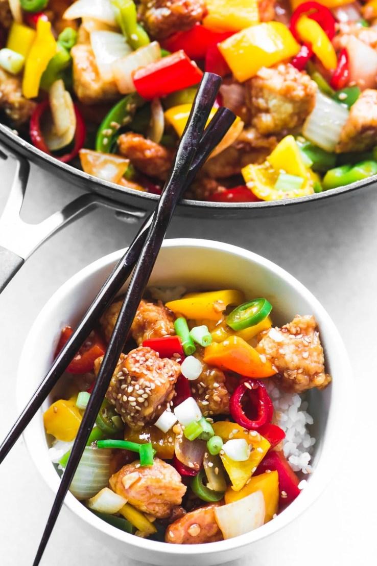 Firecracker Chicken in a bowl with chopsticks