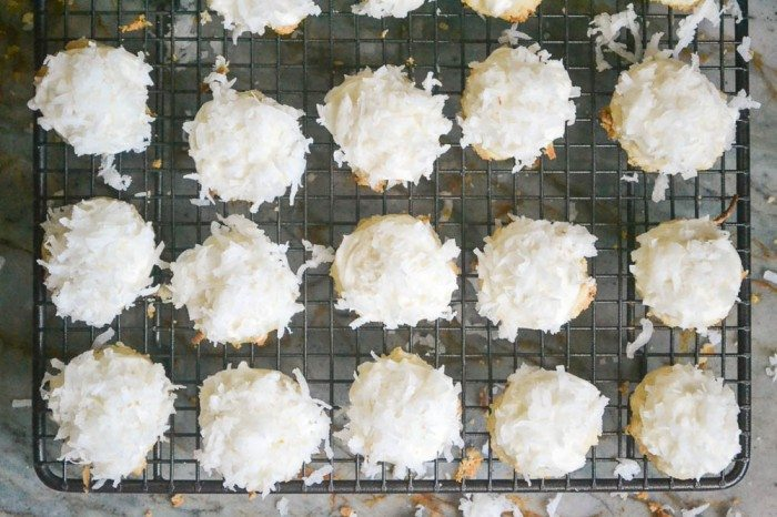 Overhead photo of coconut snowball melting moments on a baking rack.