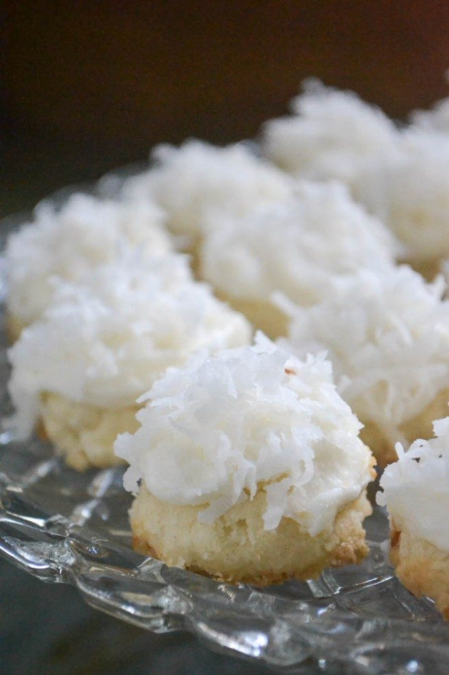 Photo of coconut snowball melting moments on a glass tray.