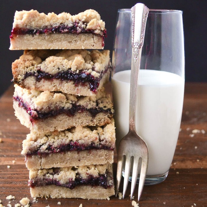 A stack of peanut buttery shortbread filled with jam