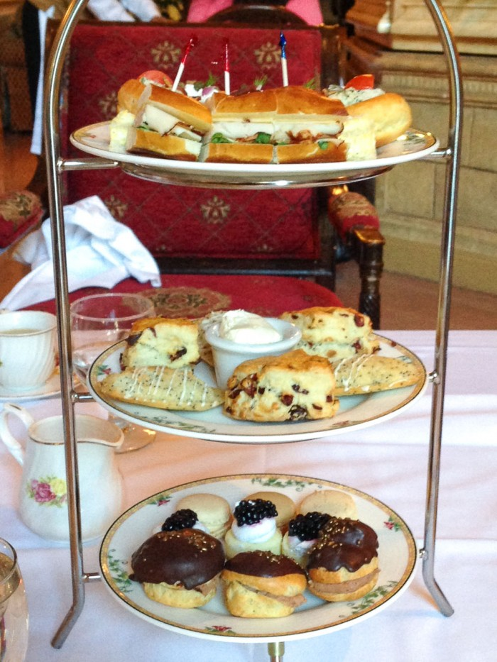 A tiered tea tray with tea sandwiches and scones for High Tea at the Biltmore