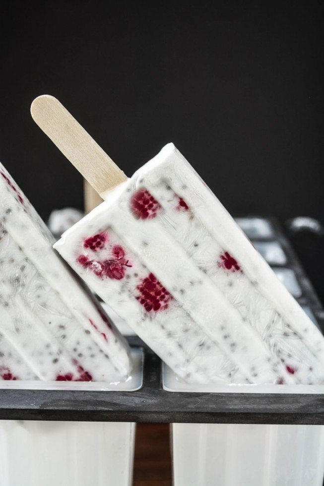 Photo of Chia coconut pudding popsicles coming out of popsicle molds.
