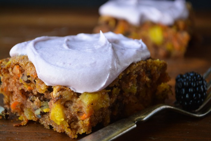 chunky carrot and pineapple cake with a berry icing