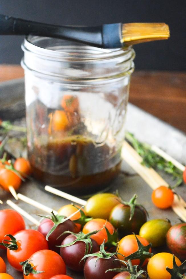 Brushing cherry tomato skewers with marinade