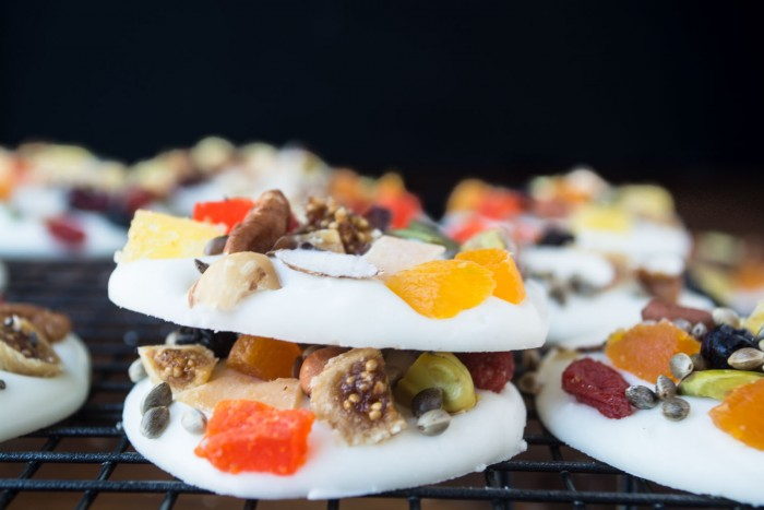 Cute as buttons, little rounds of white chocolate topped with healthy bits and pieces of fruit, nuts, and seeds