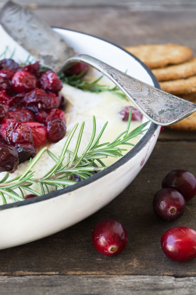 An easy holiday appetizer --- Baked Brie topped with maple roasted cranberries